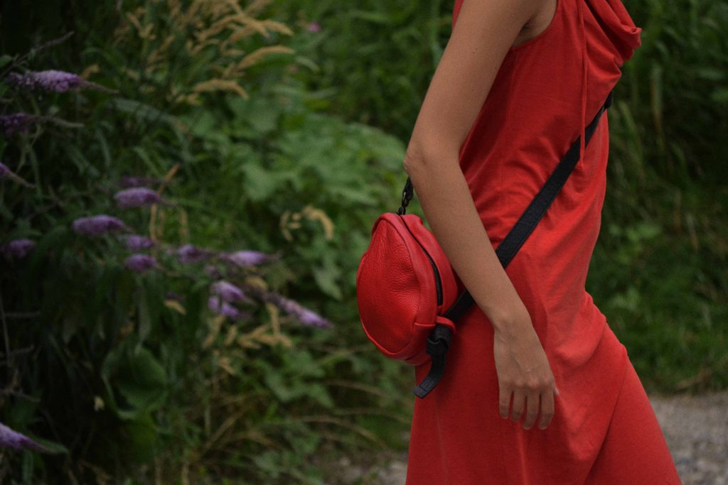 girl in red dress and red bag