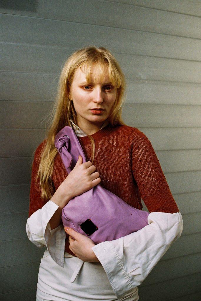 Woman holding a viola bag