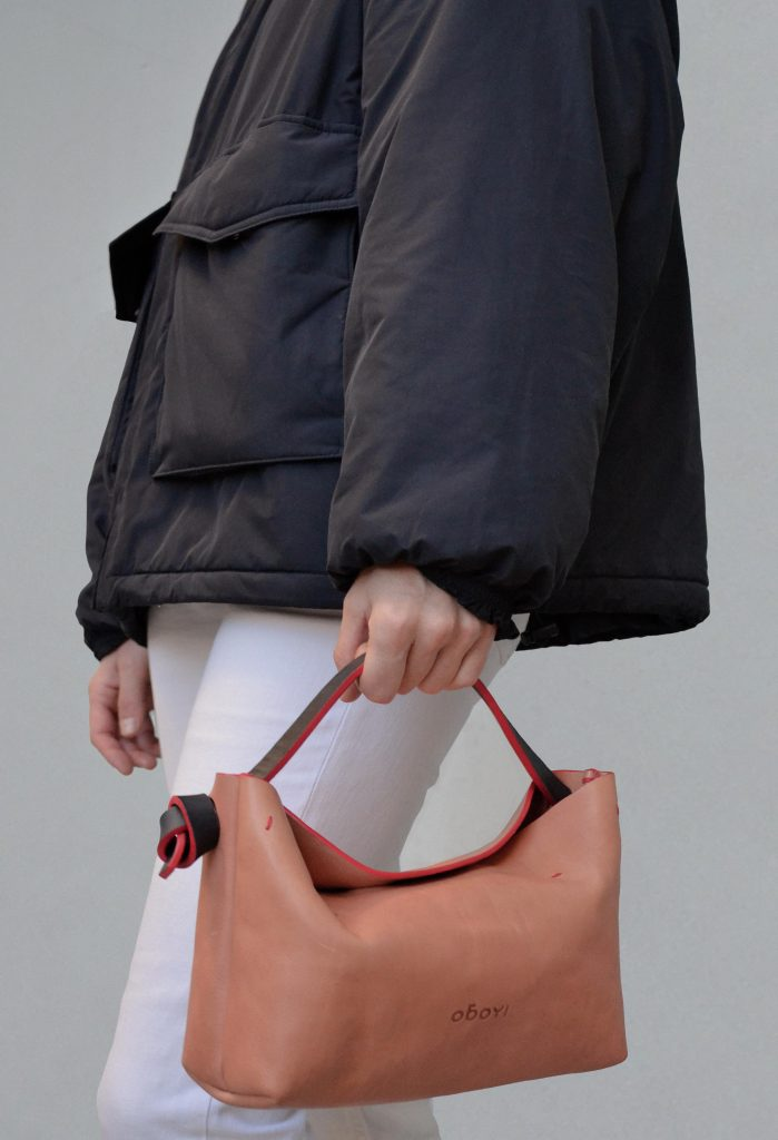 Woman with small pink leather bag