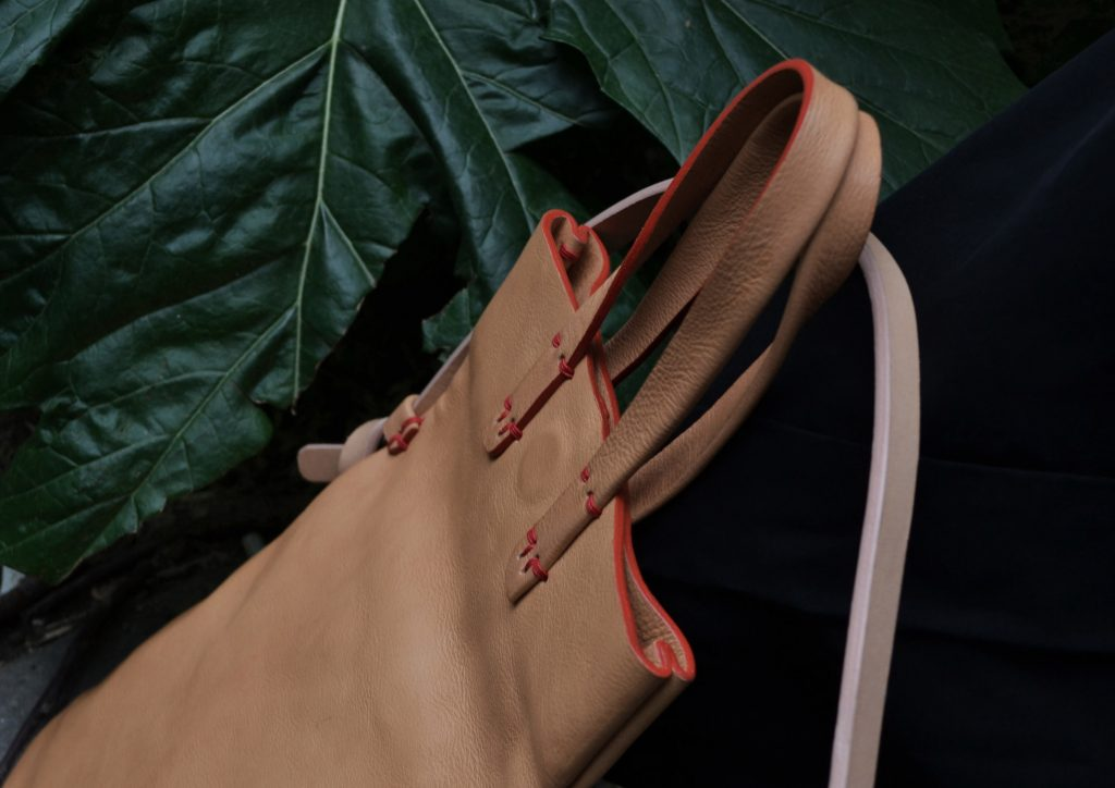 nude leather bag in the nature